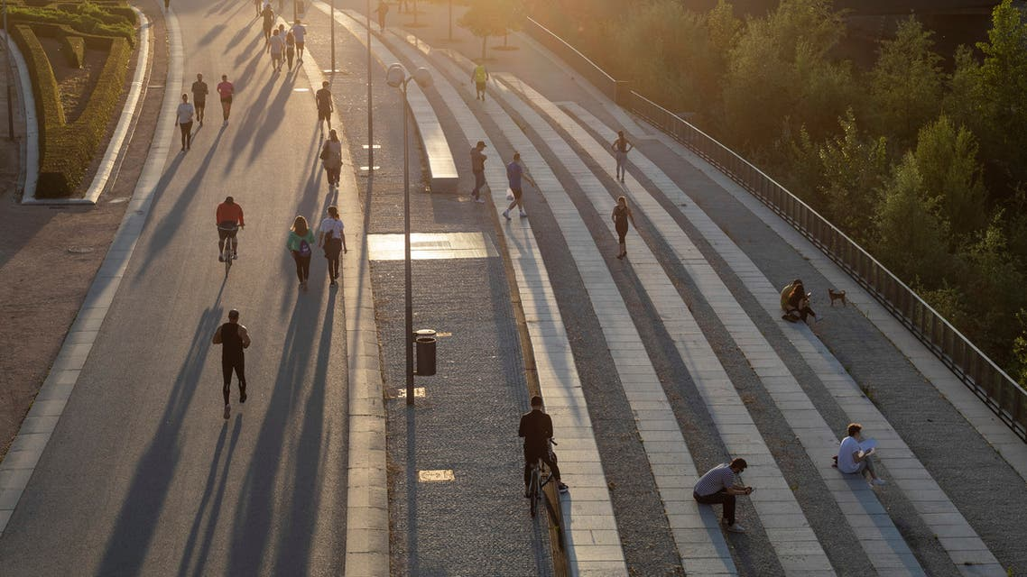 People exercise at Madrid Rio in Madrid, Spain, on Saturday, May 2, 2020. (AP)