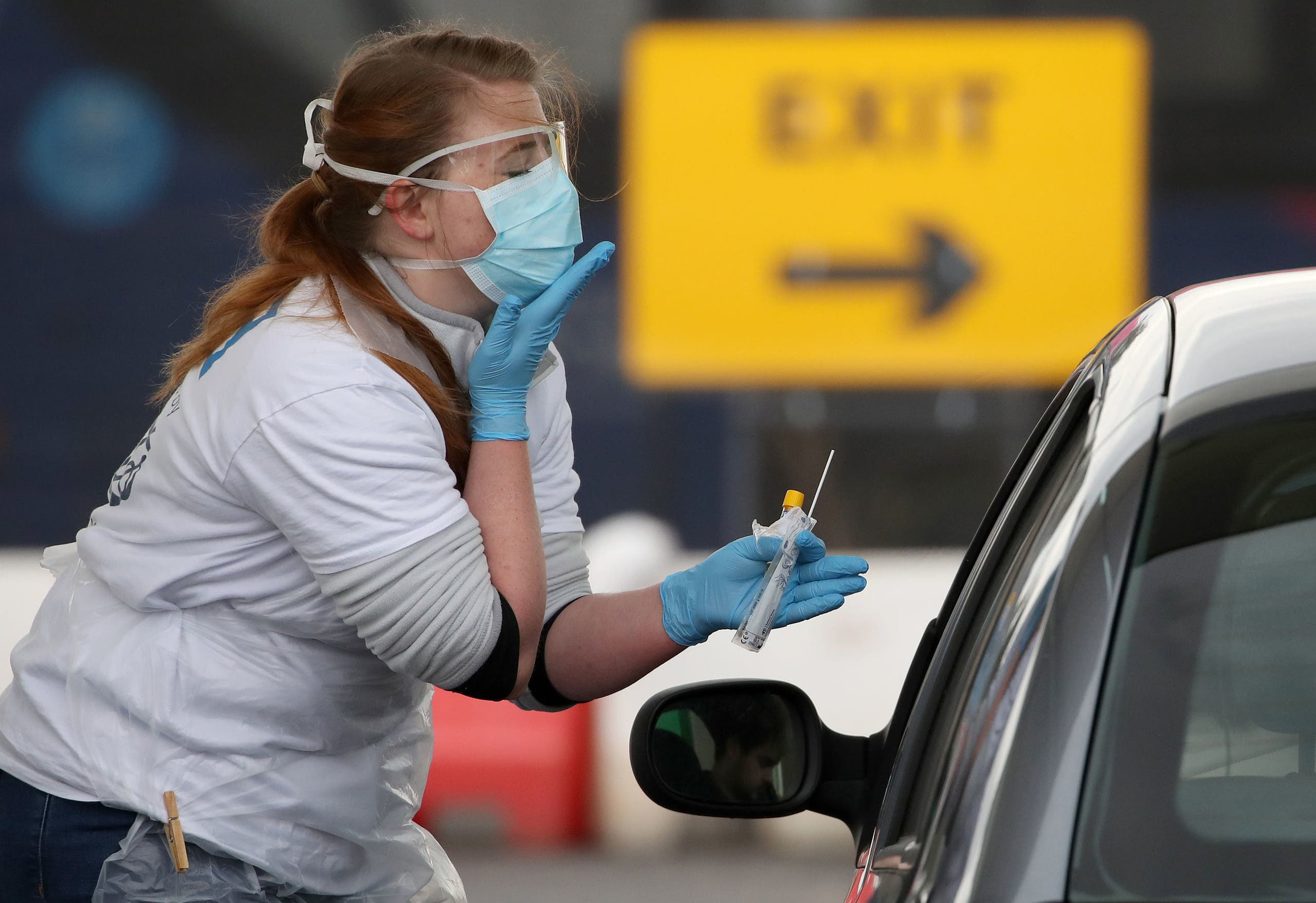 A medical worker tests a key worker for the novel coronavirus Covid-19 at a drive-in testing centre at Glasgow Airport on April 29, 2020, as the UK continues in lockdown to help curb the spread of the coronavirus.