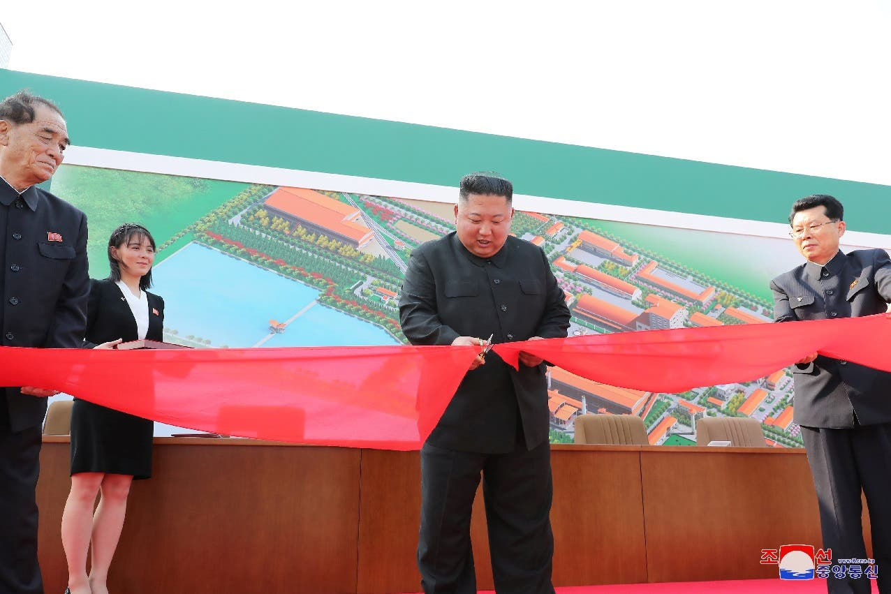 Kim Jong Un attends the completion of a fertilizer plant, together with his younger sister Kim Yo Jong, in a region north of the capital, Pyongyang, May 2, 2020. (KCNA/via Reuters)