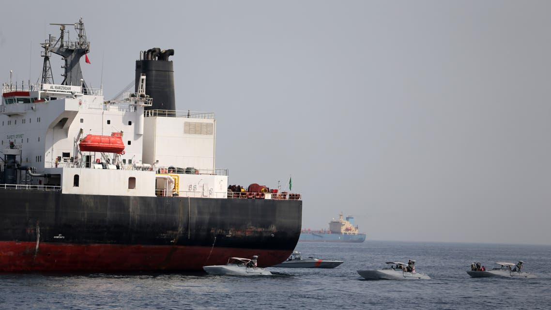 UAE Navy boats are seen next to Al Marzoqah, Saudi Arabian tanker, off the Port of Fujairah (Reuters)