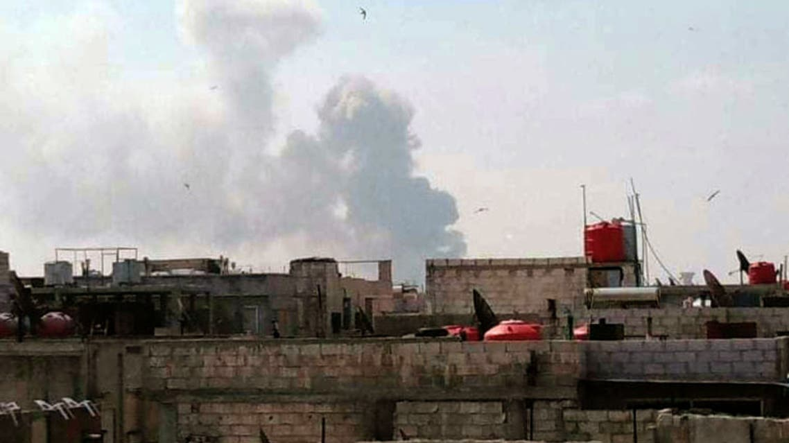 A handout picture released by the official Syrian Arab News Agency (SANA) on May 1, 2020, shows smoke billowing above buildings in Syria's central city of Homs. (AFP)