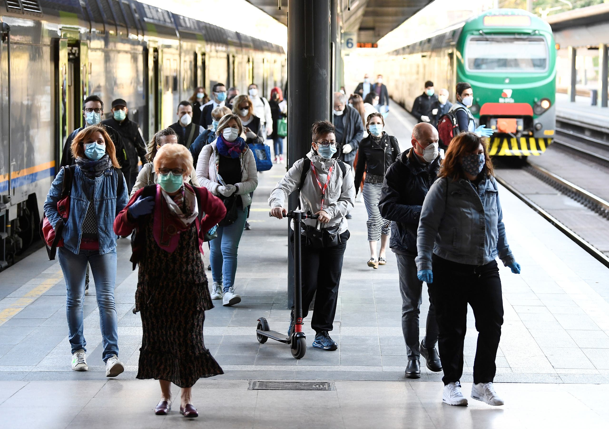 People wearing face masks arrive at the Cadorna railway station, as Italy begins a staged end to a nationwide lockdown due to the spread of the coronavirus, in Milan, Italy, on May 4, 2020. (Reuters)