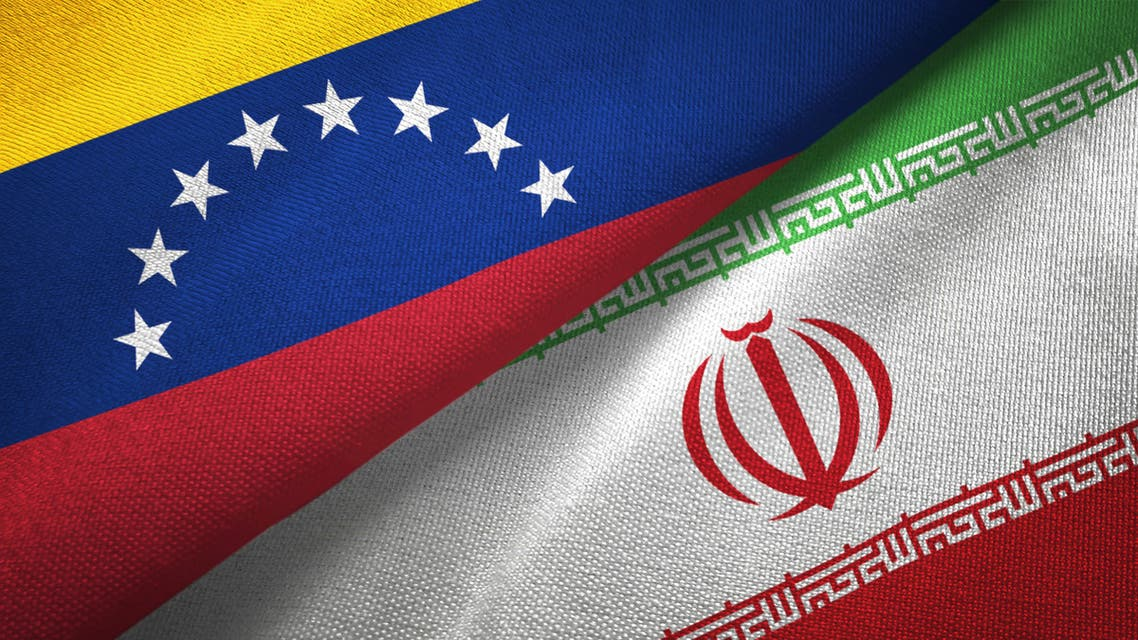 Venezuela and Iran two flags textile cloth, fabric texture stock photo