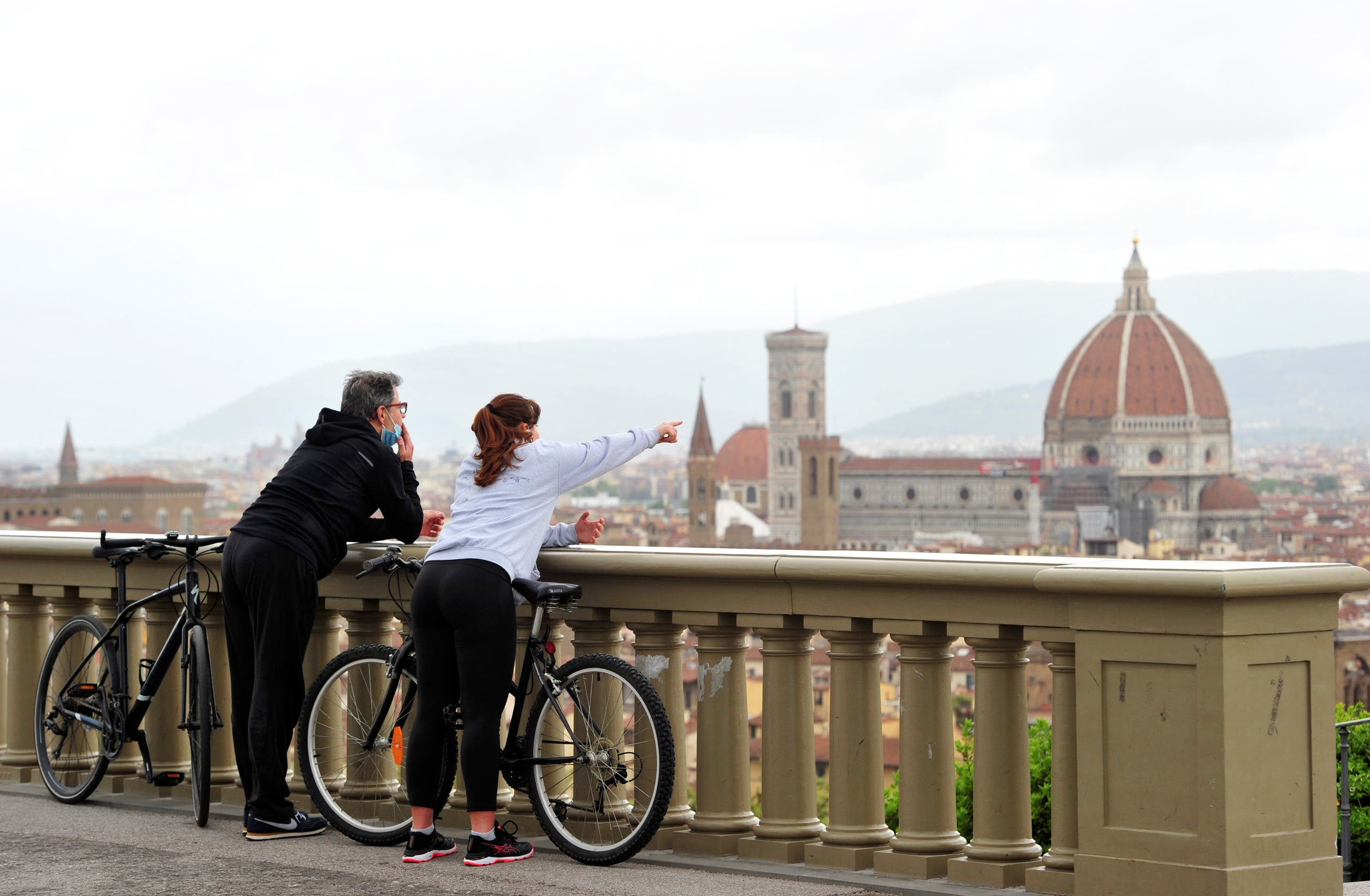 People enjoy the view of Florence from Piazzale Michelangelo in Florence, Italy, May 1, 2020. (Reuters)