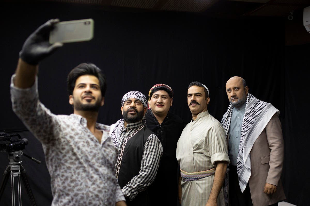 The set's makeup artist (L) takes a selfie photograph as he poses with Iraqi actors (L to R) Ayad al-Atabi, Oussama Mahdi, Youssef al-Hajjaj, and Mohammad Qassem on the set of a parody sketch video of Bab al-Hara, an adaptation of an iconic long-running Syrian television drama, in Iraq's southern port city of Basra. (AFP)