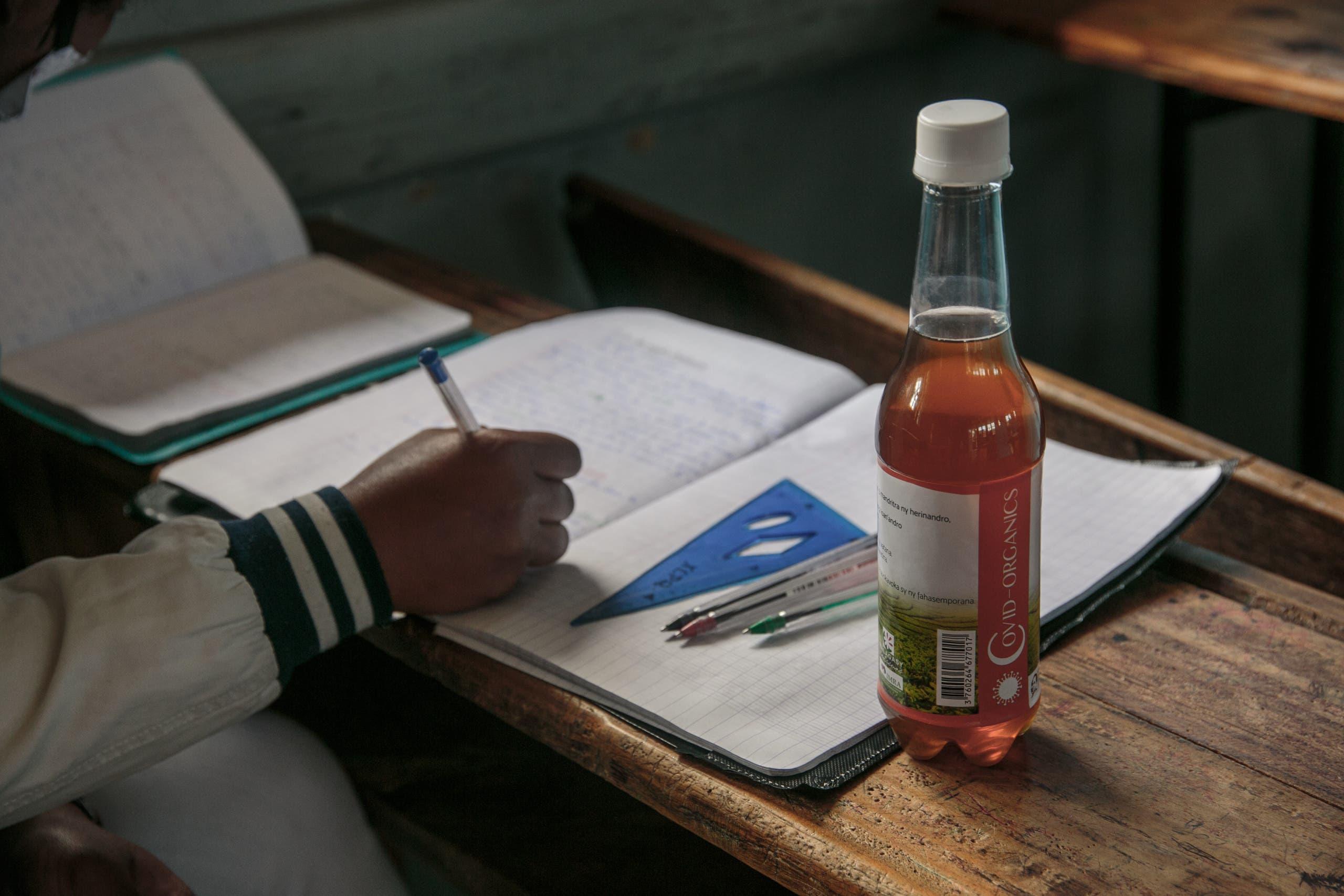 A bottle of Madagascar's herbal coronavirus 'cure' sits on a schoolchild's desk. (AFP)