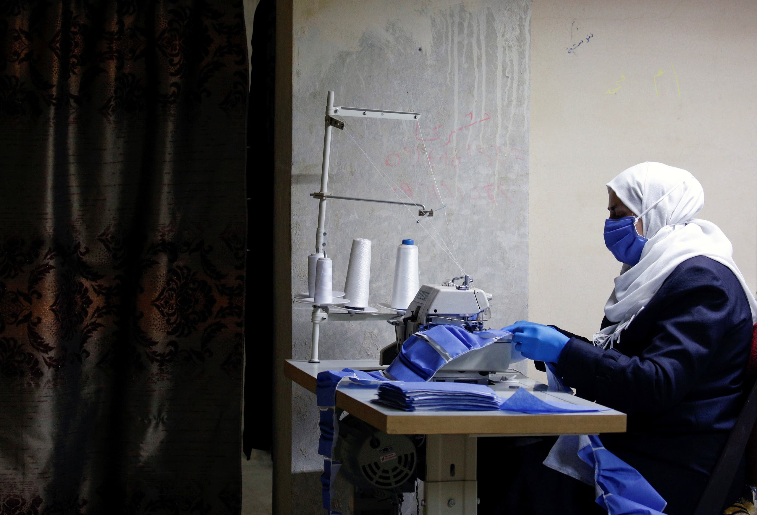 Workers make face masks in order to provide help to healthcare workers and hospitals to face the spread of coronavirus disease (COVID-19) at an atelier in Damascus, Syria April 16, 2020. (Reuters)