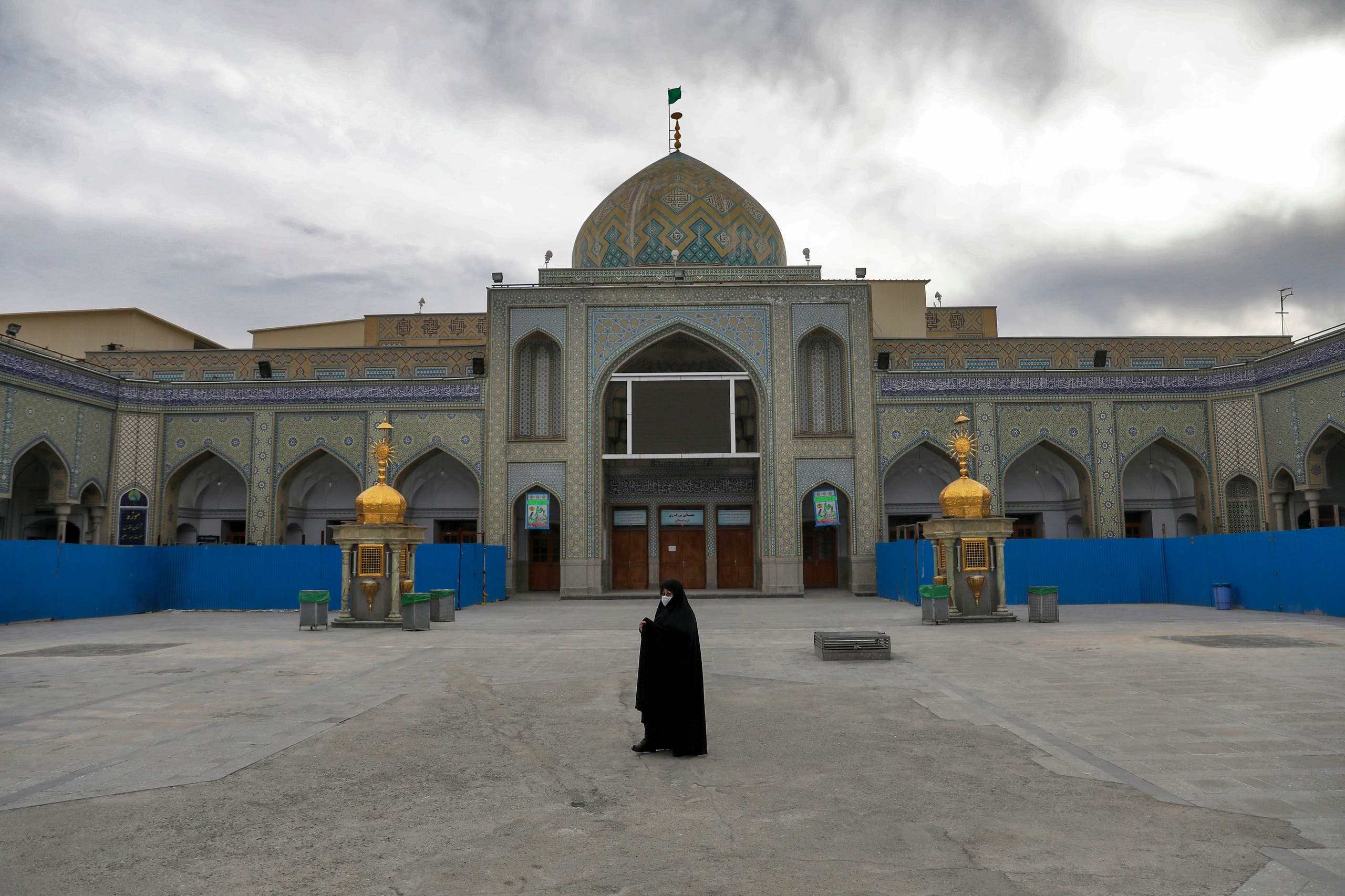 A woman with a mask walks in the yard of a Friday prayer mosque in Shahr-e-Ray, south of Tehran, Iran. (File Photo: AP)