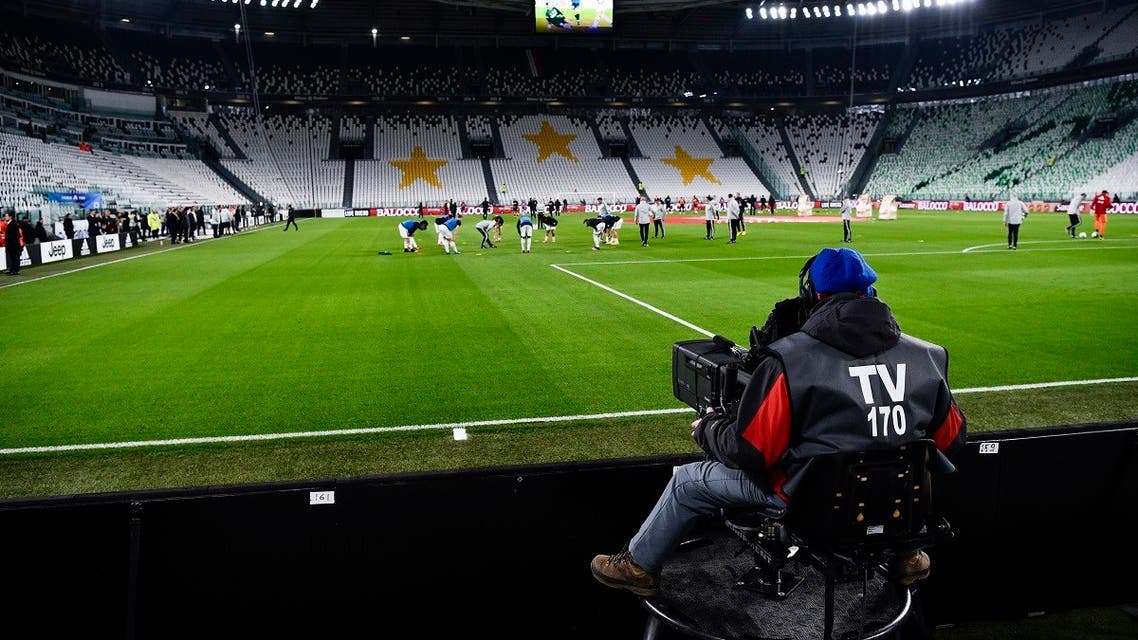 Players warm up in the empty Allianz stadium, prior to the Serie A football match between Juventus and Inter Milan. (File photo: AP)