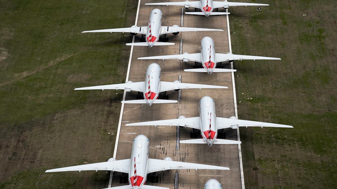 American Airlines passenger planes crowd a runway where they are parked due to flight reductions at Tulsa International Airport in Tulsa, Oklahoma, on March 23, 2020. (Reuters)