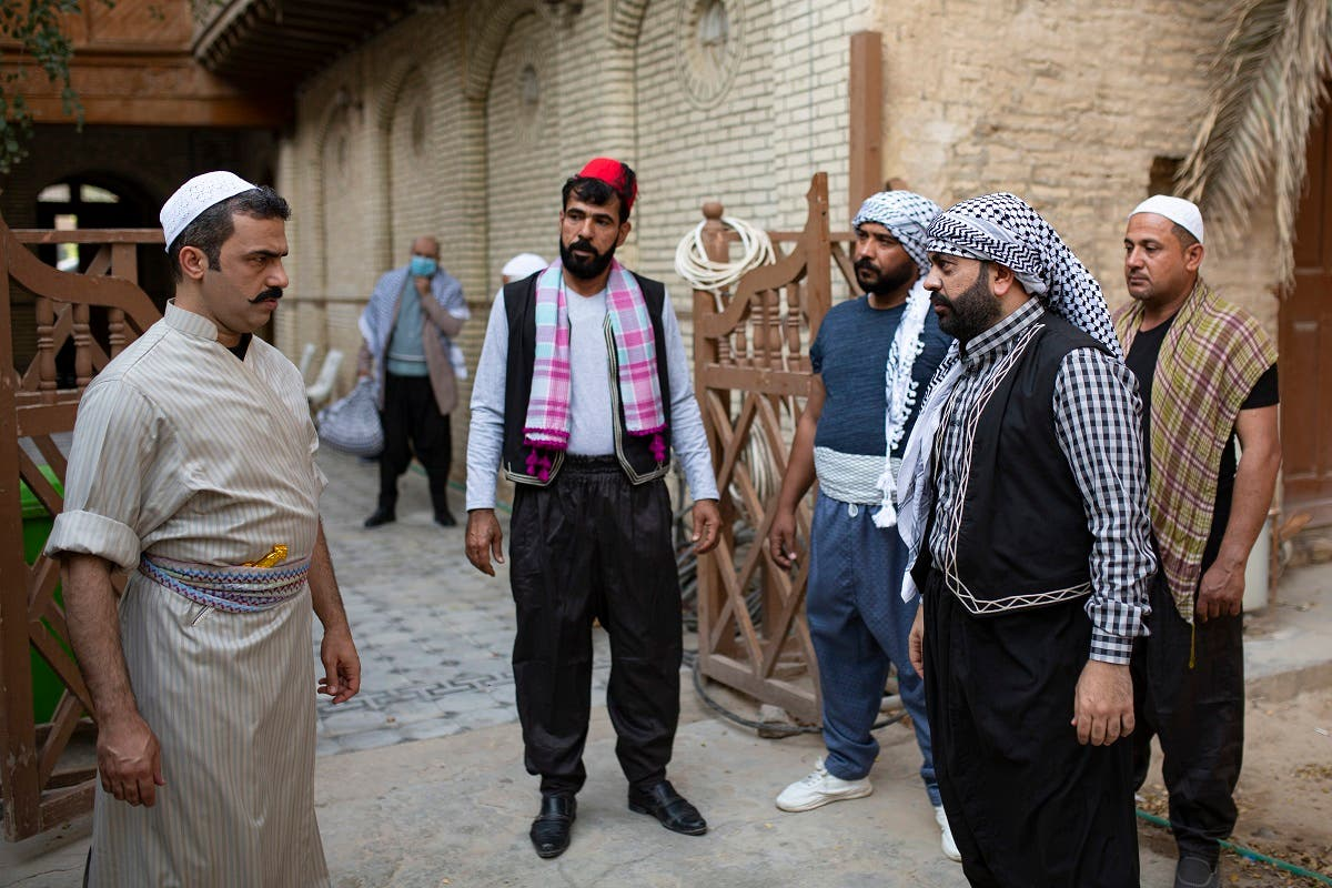 Iraqi actors act out a scene of a parody sketch video adaptation of Bab al-Hara, a long-running iconic Syrian television drama, to raise awareness through videos on the COVID-19 coronavirus pandemic in Iraq's southern port city of Basra on April 22, 2020. (AFP)