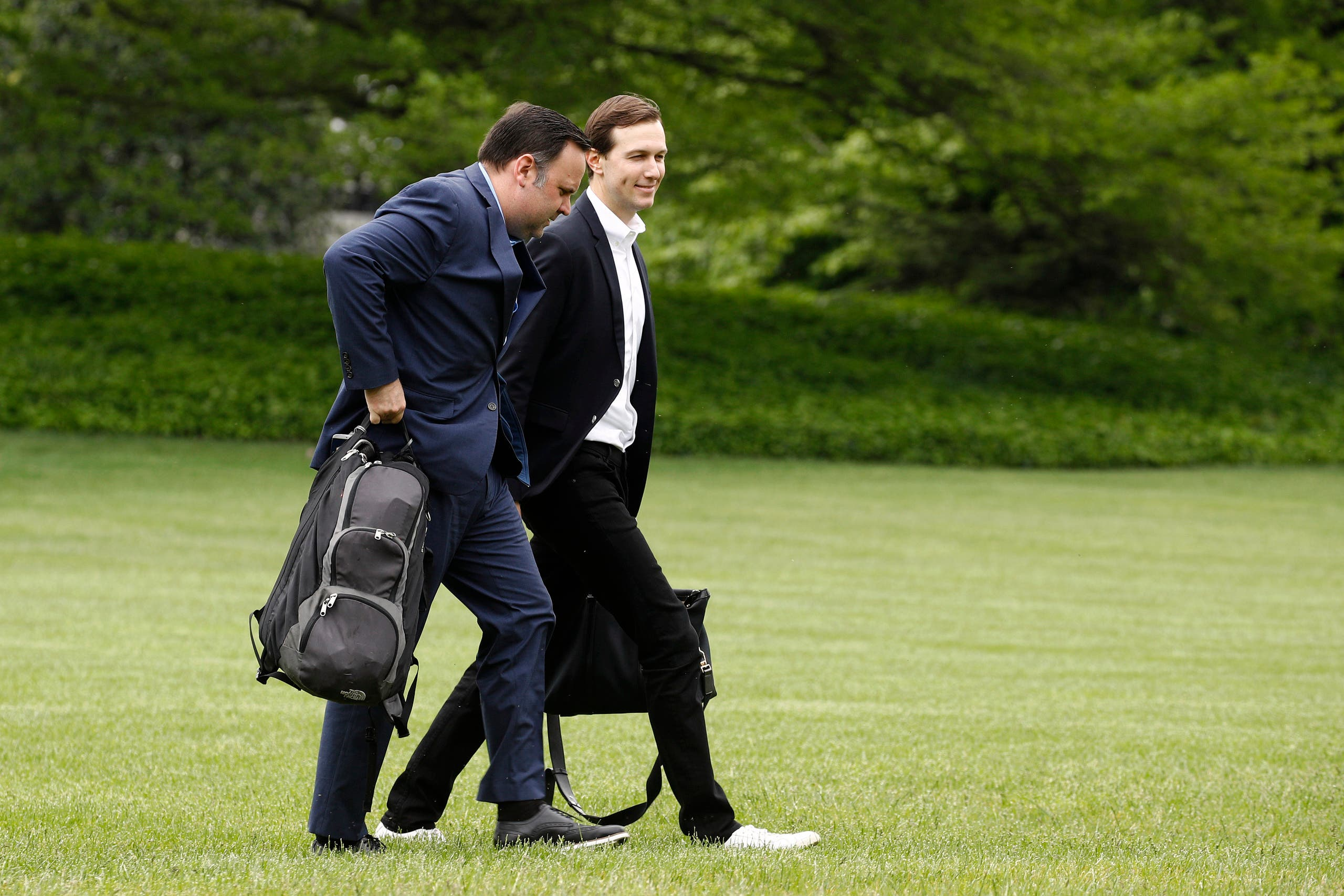White House Social Media Director Dan Scavino, left, and President Donald Trump's White House Senior Adviser Jared Kushner walk on the South Lawn of the White House after stepping off Marine One with President Trump, Sunday, May 3, 2020, in Washington.  (AP)