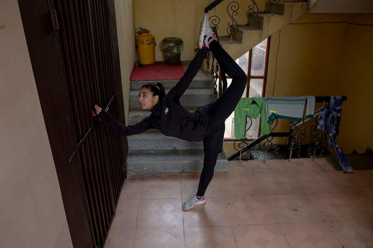 Kashmiri Taekwondoin Afreen Hyder practises in her apartment's corridor in Srinagar, Indian controlled Kashmir, April 19, 2020. (AP)