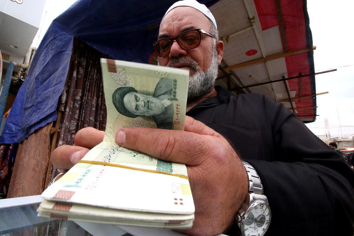 A man buys Iranian rials from a seller of Iranian currency, before the start of the US sanctions on Tehran, in Basra, Iraq. (File photo: Reuters)