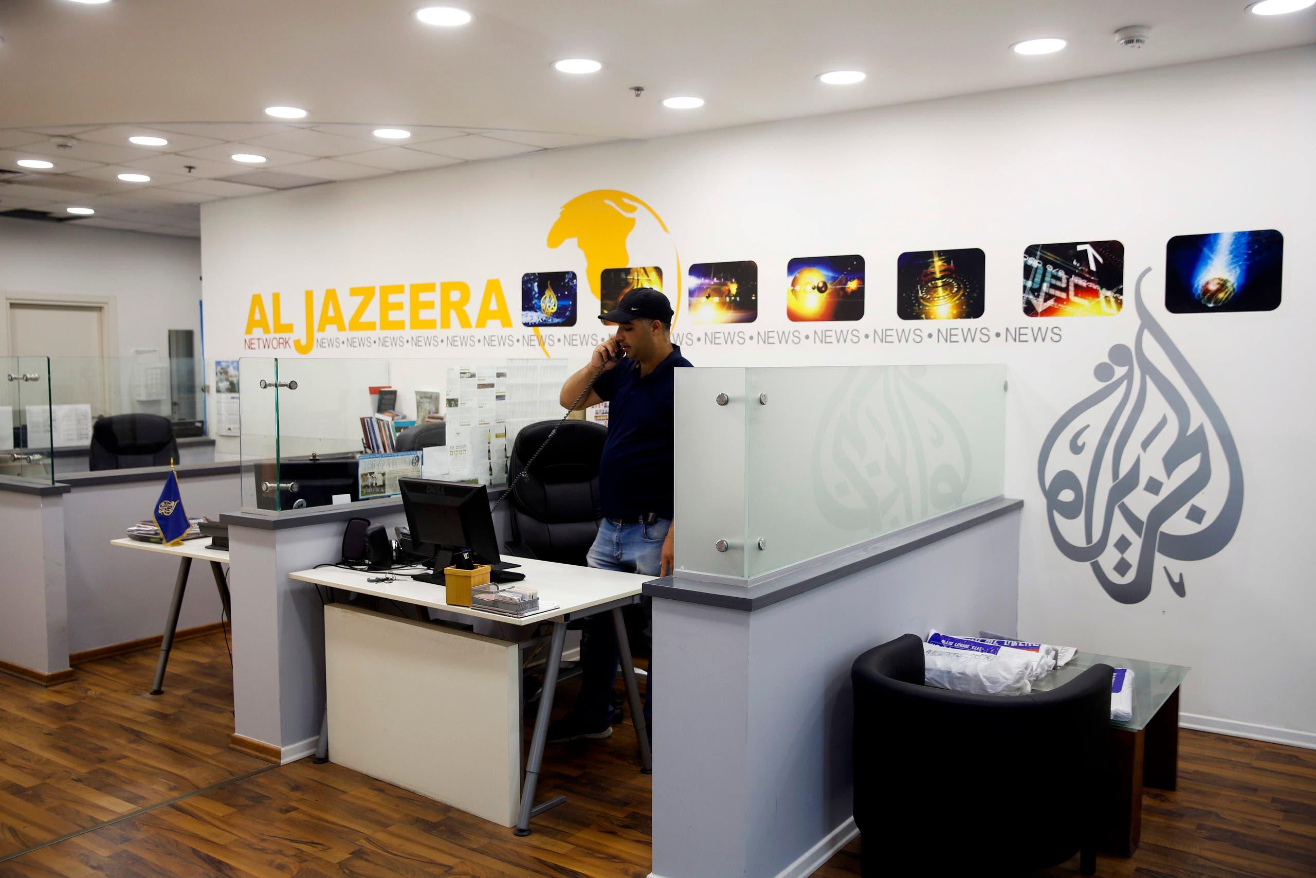 An employee talks on the phone in Al-Jazeera news network offices in Jerusalem. (File photo: AP)