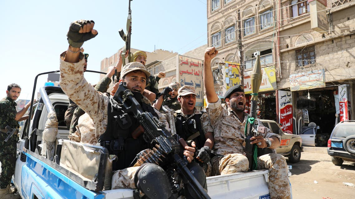 Houthi troops ride on the back of a police patrol truck after participating in a Houthi gathering in Sanaa, Yemen February 19, 2020. (Reuters)