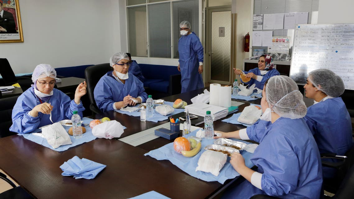 Doctor Meryem Bouchbika and medical stuff eat lunch in the office at Prince Moulay Abdellah hospital as the spread of the coronavirus disease (COVID-19) continues in Sale, Morocco April 23, 2020. (Reuters)