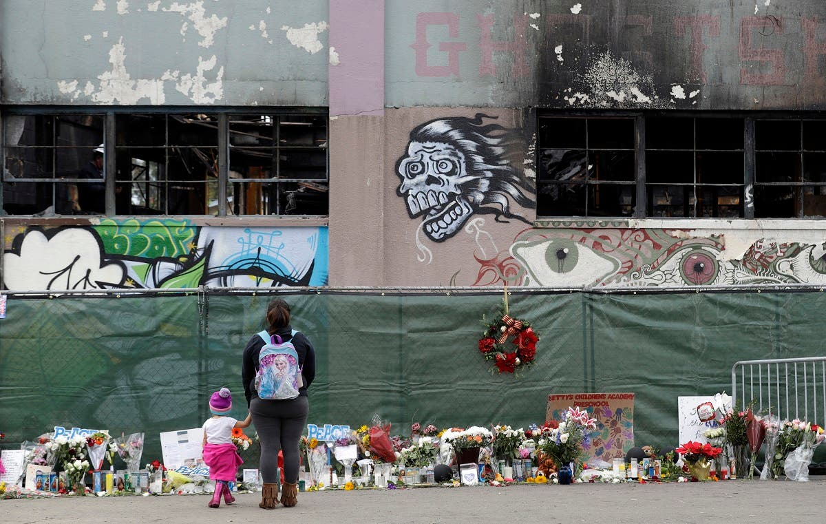 In this Dec. 13, 2016, file photo, flowers, pictures, signs and candles, are placed at the scene of a warehouse fire in Oakland, Calif. (AP)