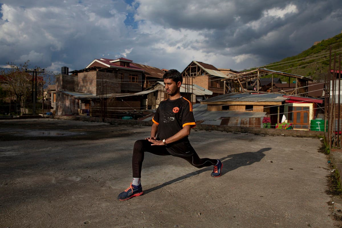 An ultra-marathon runner Hamid Aziz practises on the roof of an abandoned community hall outside his house in Srinagar Indian controlled Kashmir, on April 21, 2020.  (AP)