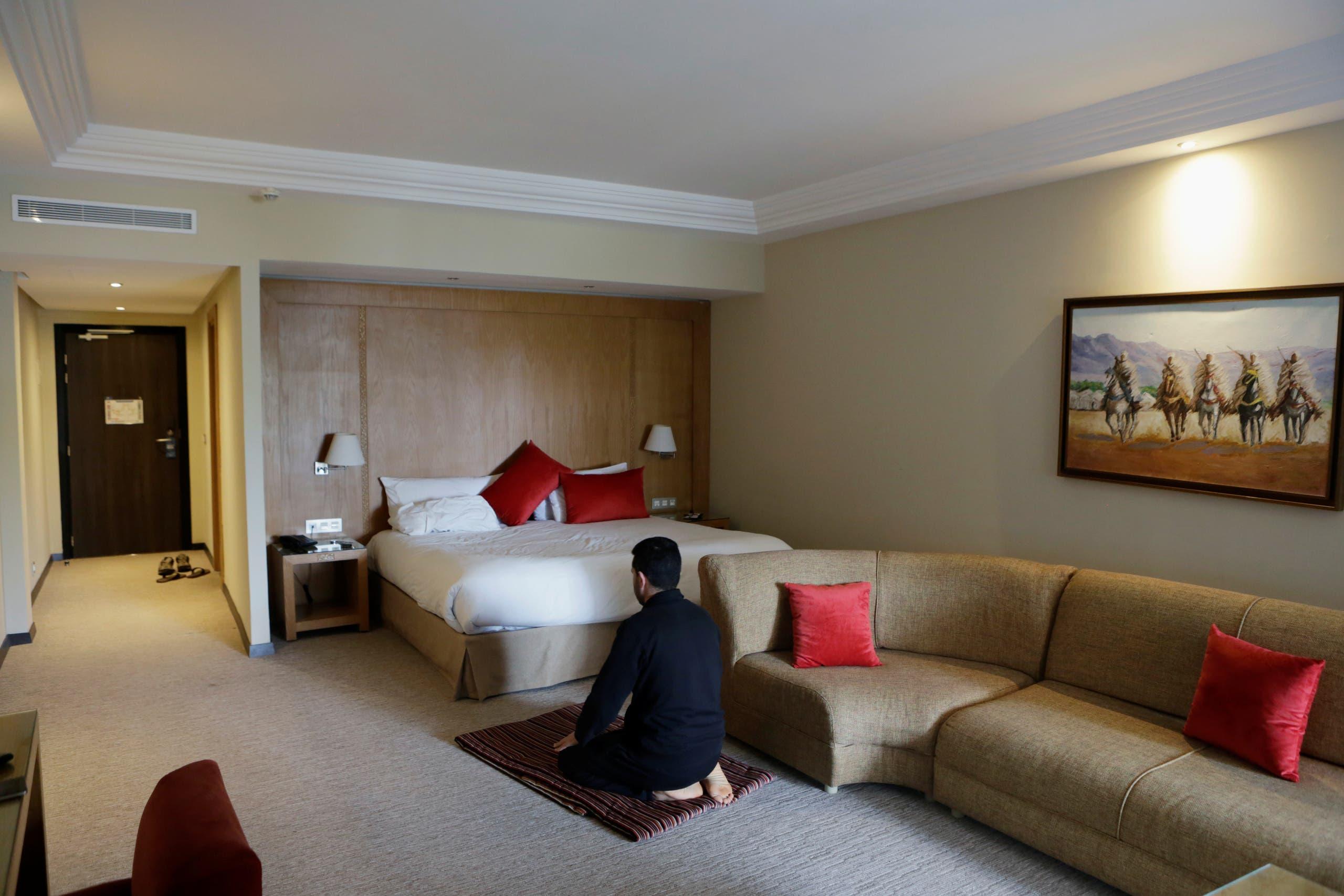 Nurse anesthetist Jamal Bekali, prays in his room at the hotel Dawliz in Sale. (Reuters)
