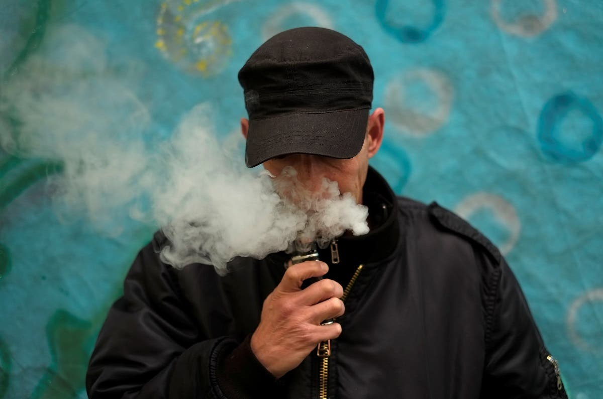 A man poses for a picture, as he vapes at home in La Paz. (Reuters)