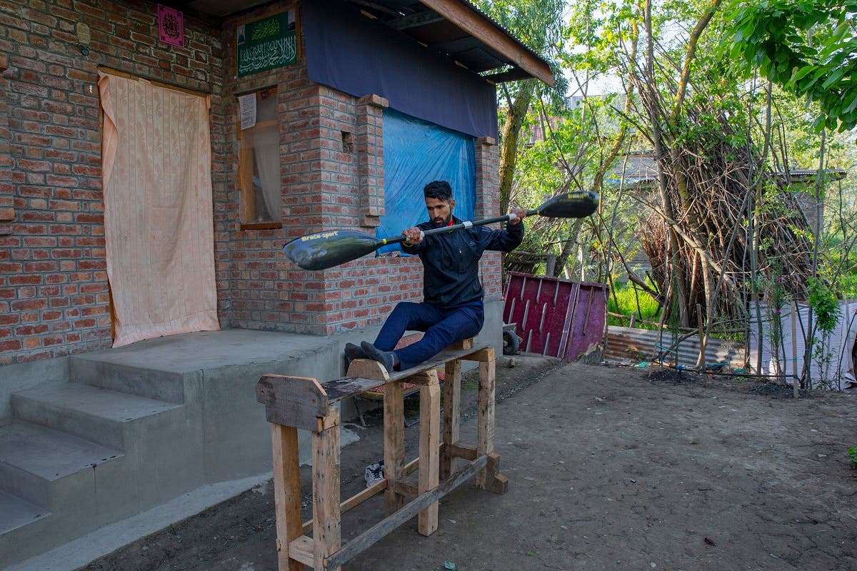 Kashmiri kayaker Vilayat Hussain practises on a rugged under-construction wooden ergometer at his home on the outskirts of Srinagar, Indian controlled Kashmir, on April 24, 2020. (AP)