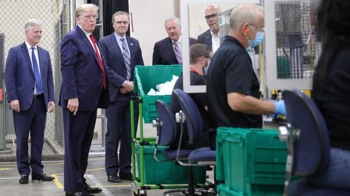 US President Donald Trump observes an assembly line during a visit to a Honeywell facility making face masks for the coronavirus outbreak in Phoenix, Arizona, US, May 5, 2020. (Reuters)