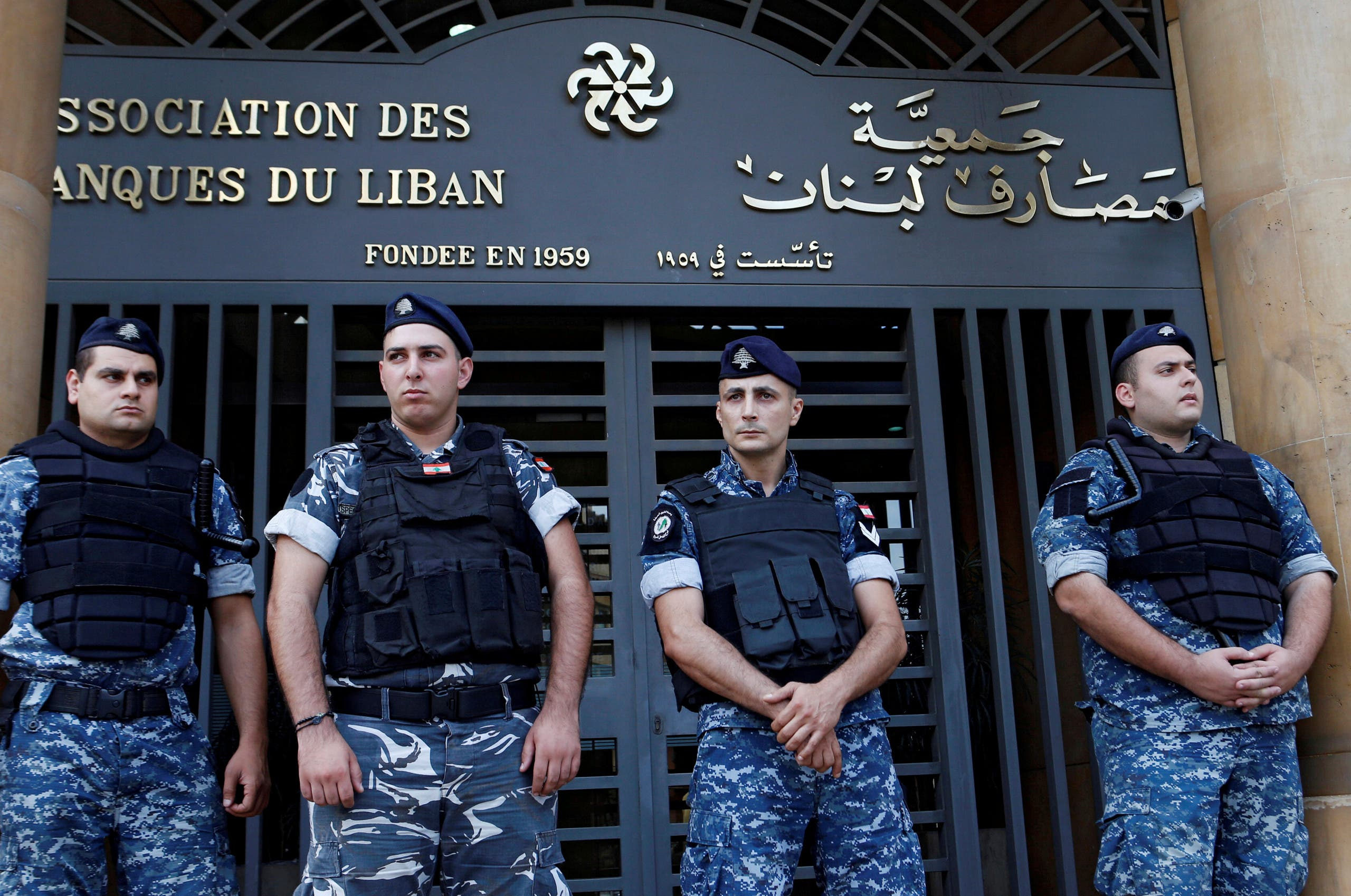 Lebanese police stand outside the entrance of the Association of Banks in downtown Beirut, Lebanon on November 1, 2019. (Reuters)