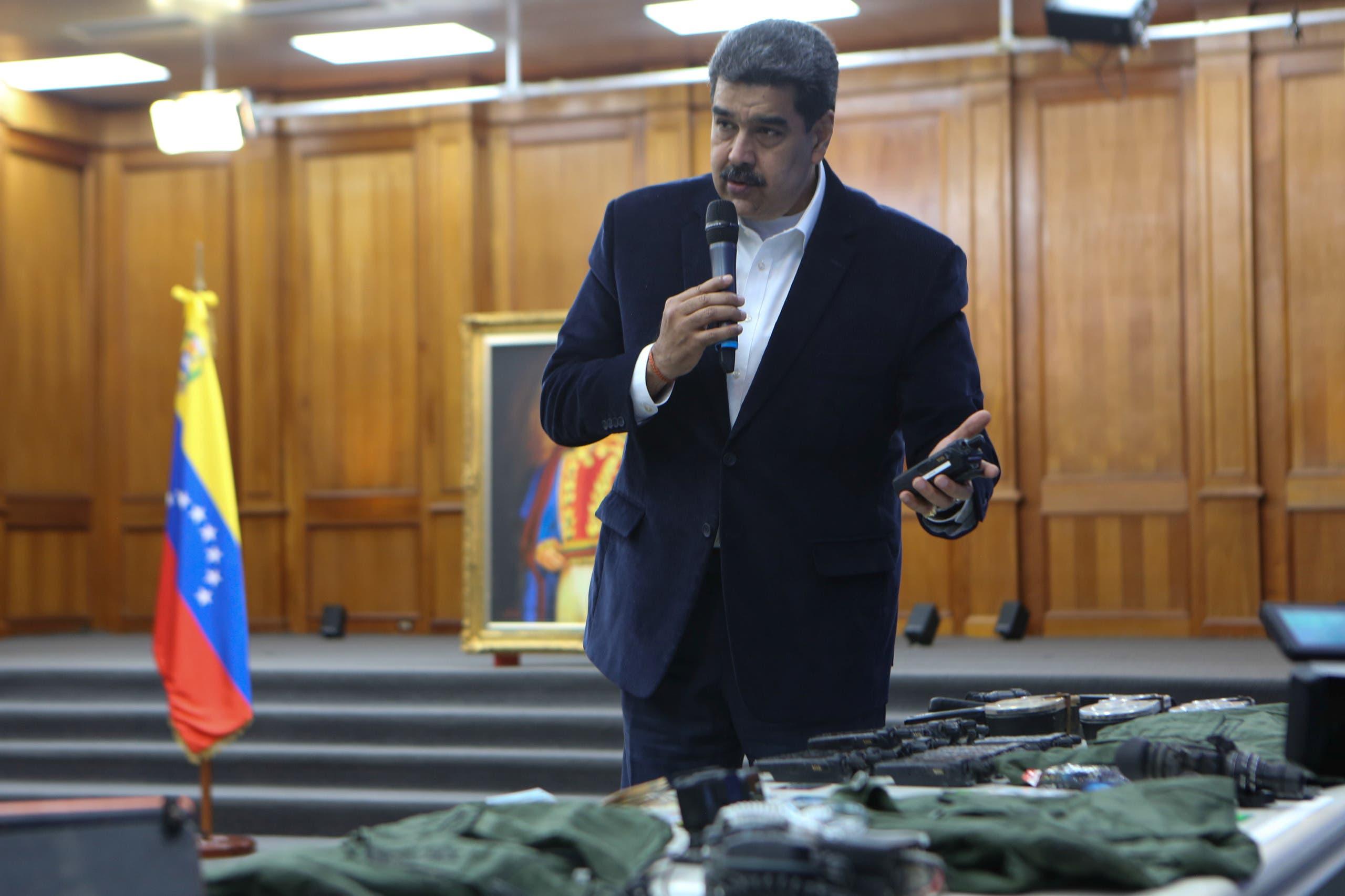 Venezuela's President Nicolas Maduro shows military equipment at Miraflores Palace in Caracas, Venezuela, May 4, 2020. (Miraflores Palace/Handout via Reuters)