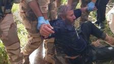 """شاهد.. القوات العراقية تخرج داعشياً من """"وكره""""!"""