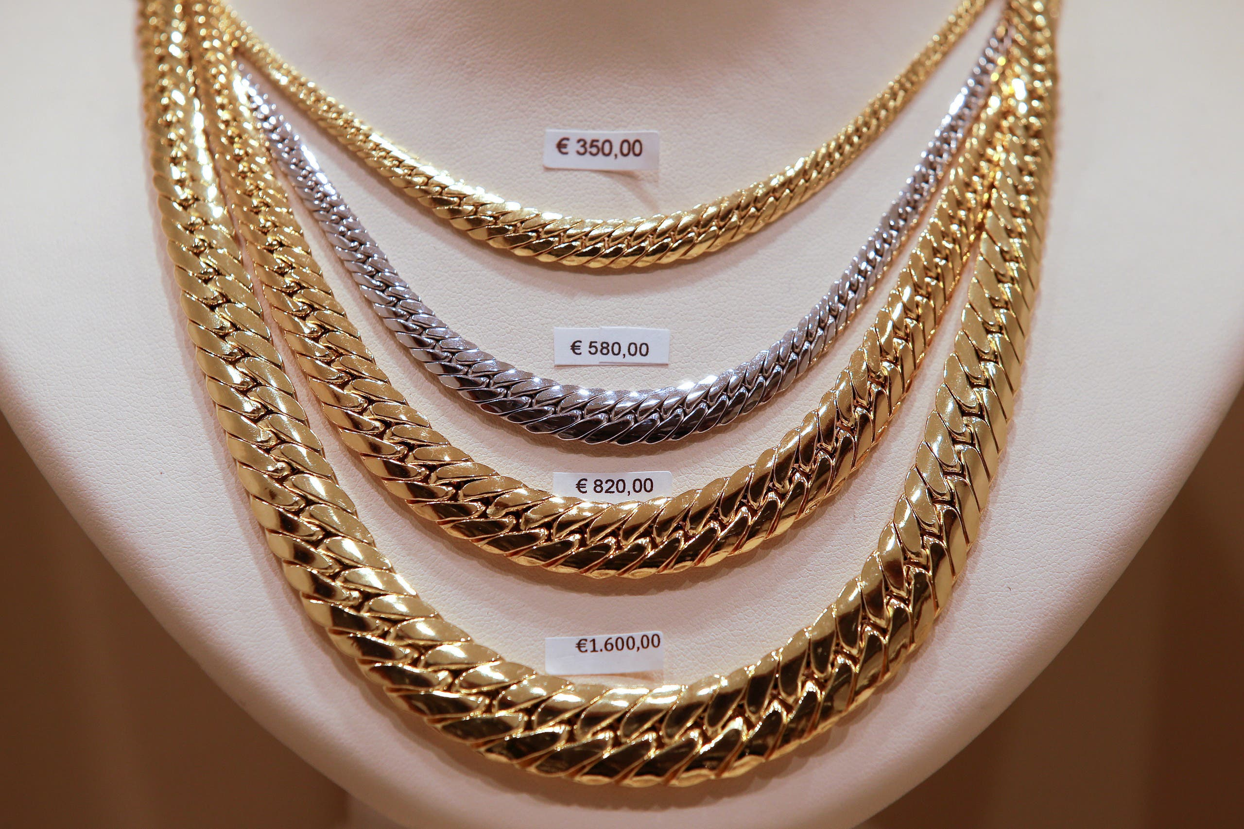 Gold necklaces are seen in a jewelry shop in downtown Rome, Italy, December 11, 2017. (Reuters)
