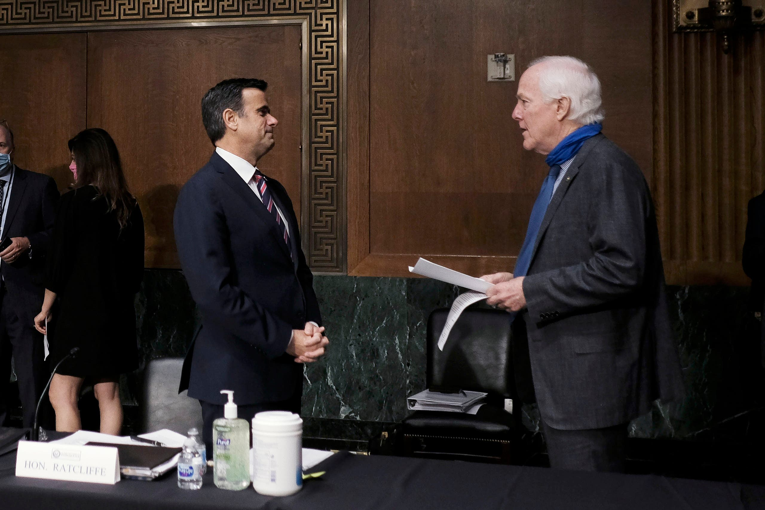 Donald Trump's nominee to lead US intelligence John Ratcliff talks with Senator John Cornyn, at the top of a Senate Intelligence Committee nomination hearing on Capitol Hill in Washington, on May 5, 2020. (AP)