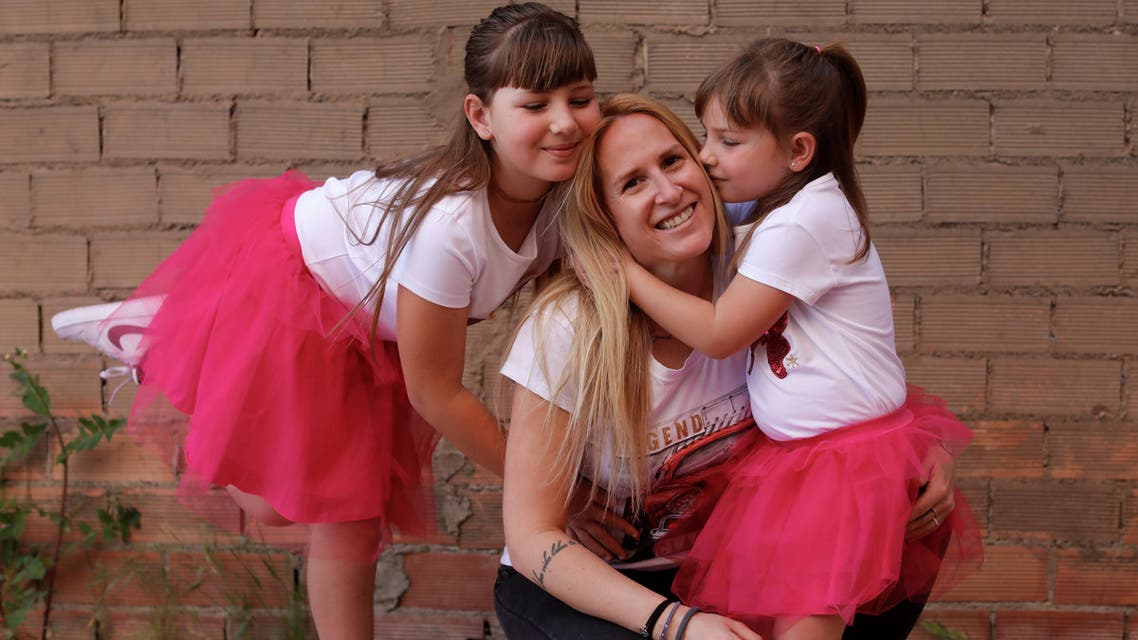 Esther Gallardo, a laboratory technician, is embraced by her daughters during a lockdown amid the coronavirus outbreak, in Ronda, Spain, May 3, 2020. (Reuters)