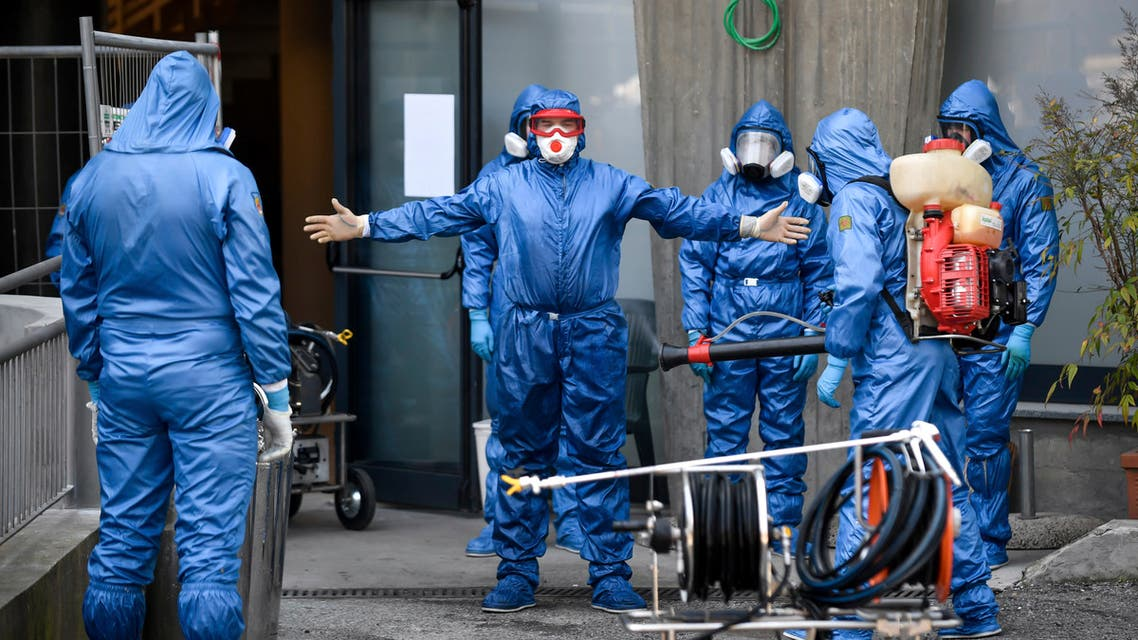Members of a Russian team sanitize a hospice for elderly people to contain the spread of the Covid-19 virus, in Albino, near Bergamo, northern Italy on March 28, 2020. (AP)
