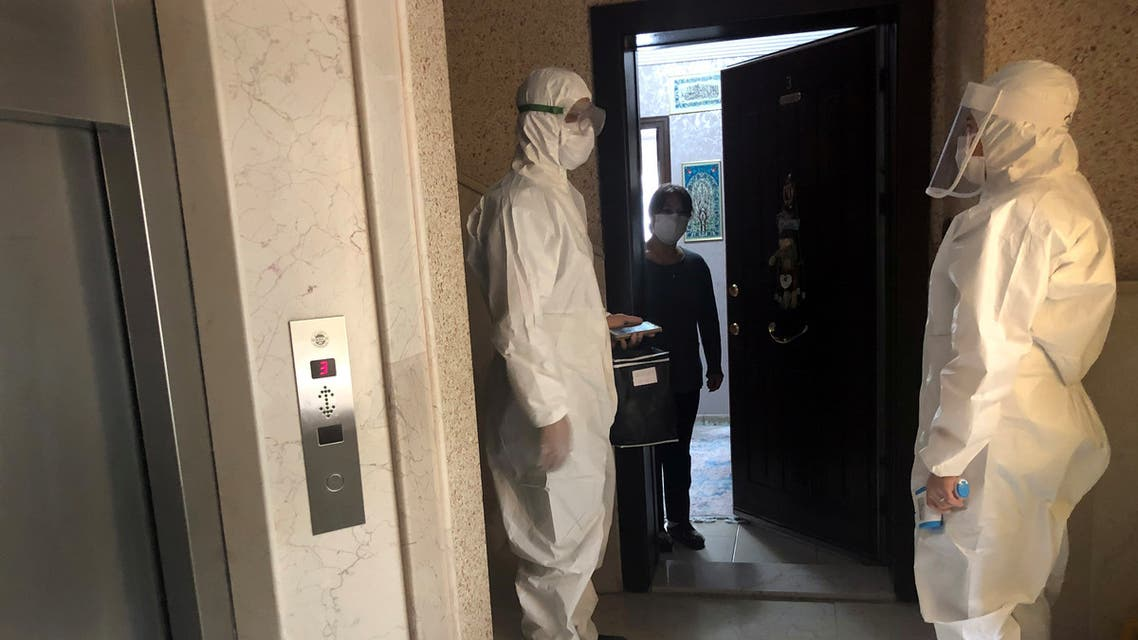 Medics wearing protective suits, members of Turkish Health Ministry's coronavirus contact tracing team, visit a home to check a suspected coronavirus disease (COVID-19) case in Ankara, Turkey, April 27, 2020. Picture taken April 27, 2020. REUTERS/Tuvan Gumrukcu