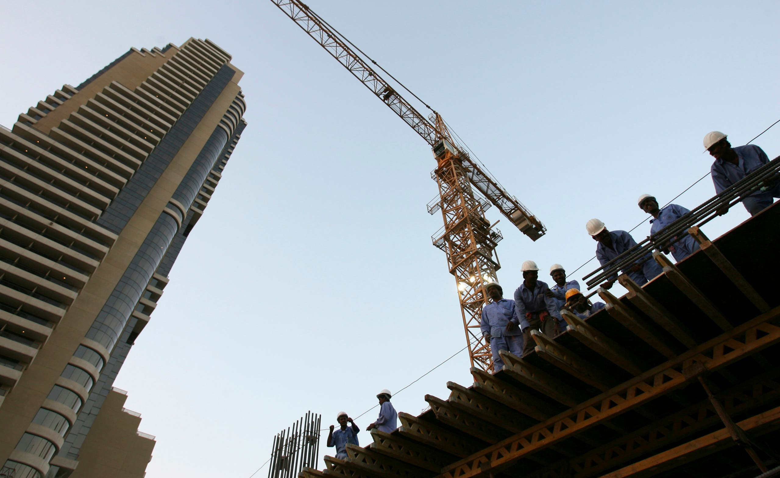Foreign workers are seen in a bus at a construction site in Dubai, United Arab Emirates, November 13, 2006. (Reuters)