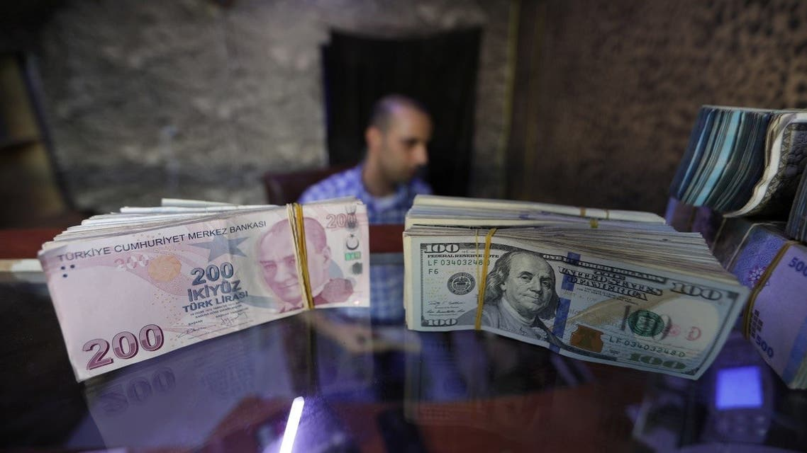 Banknotes of U.S. dollars and Turkish lira are seen in a currency exchange shop in the city of Azaz. (Reuters)