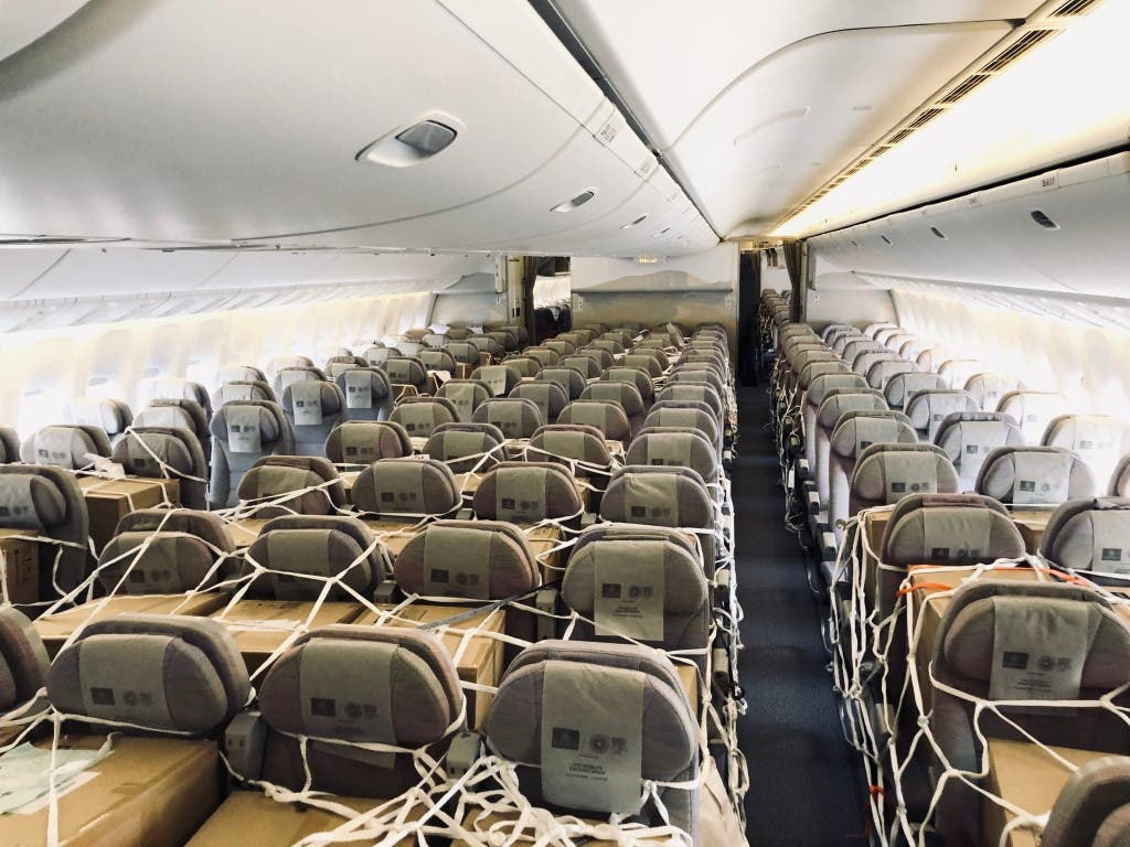 Emirates SkyCargo loads cargo in overhead bins and seats inside the cabin of Boeing 777-300ER passenger aircraft. (WAM)