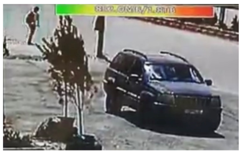 The driver stands feet from the car before it exploded. (Screengrab.)