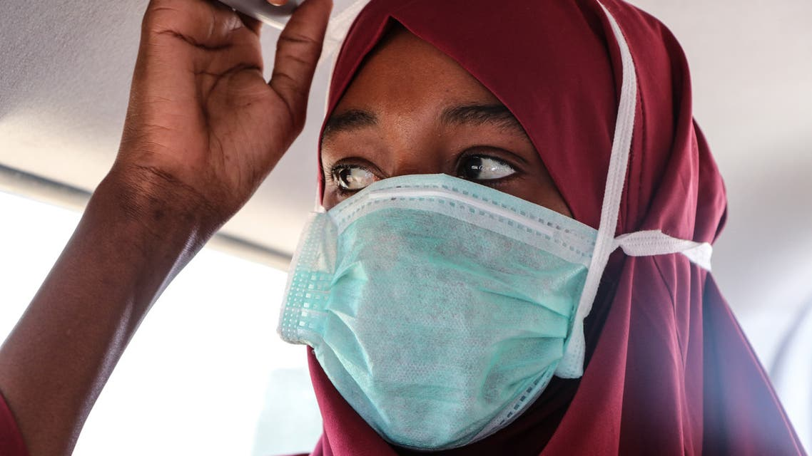 A suspected patient with the COVID-19 Coronavirus is transfered to the public hospital by ambulance in Mogadishu on March 29, 2020. (AFP)