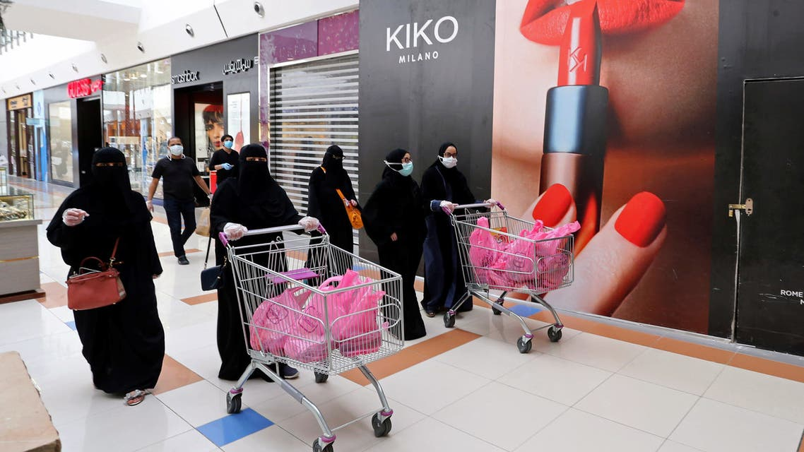 Women shop at a shopping mall after the Saudi government eased a curfew and allowed stores to open, following the outbreak of the coronavirus disease (COVID-19), in Riyadh. (Reuters)