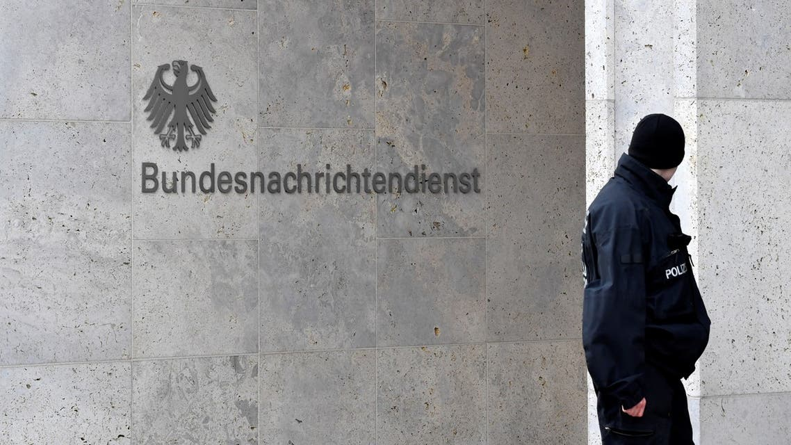 A policeman stands guard next to the logo and name of the German Federal Intelligence Service (BND) on February 8, 2019 outside its headquarters in Berlin. Located where the Berlin Wall once dissected the city, the 1.1 billion euro ($1.25 billion) complex now houses 4,000 of the spy agency's 6,500 staff.