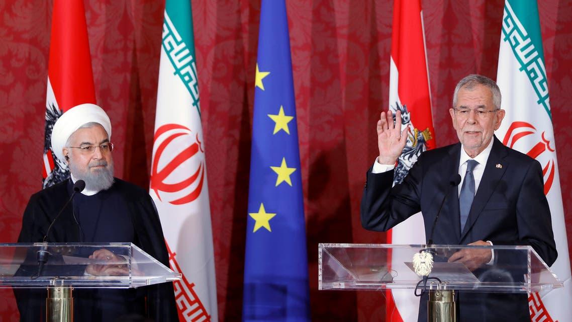 Austrian President Alexander Van der Bellen and Iranian President Hassan Rouhani attend a news conference in Vienna, Austria, July 4, 2018. REUTERS/Leonhard Foeger