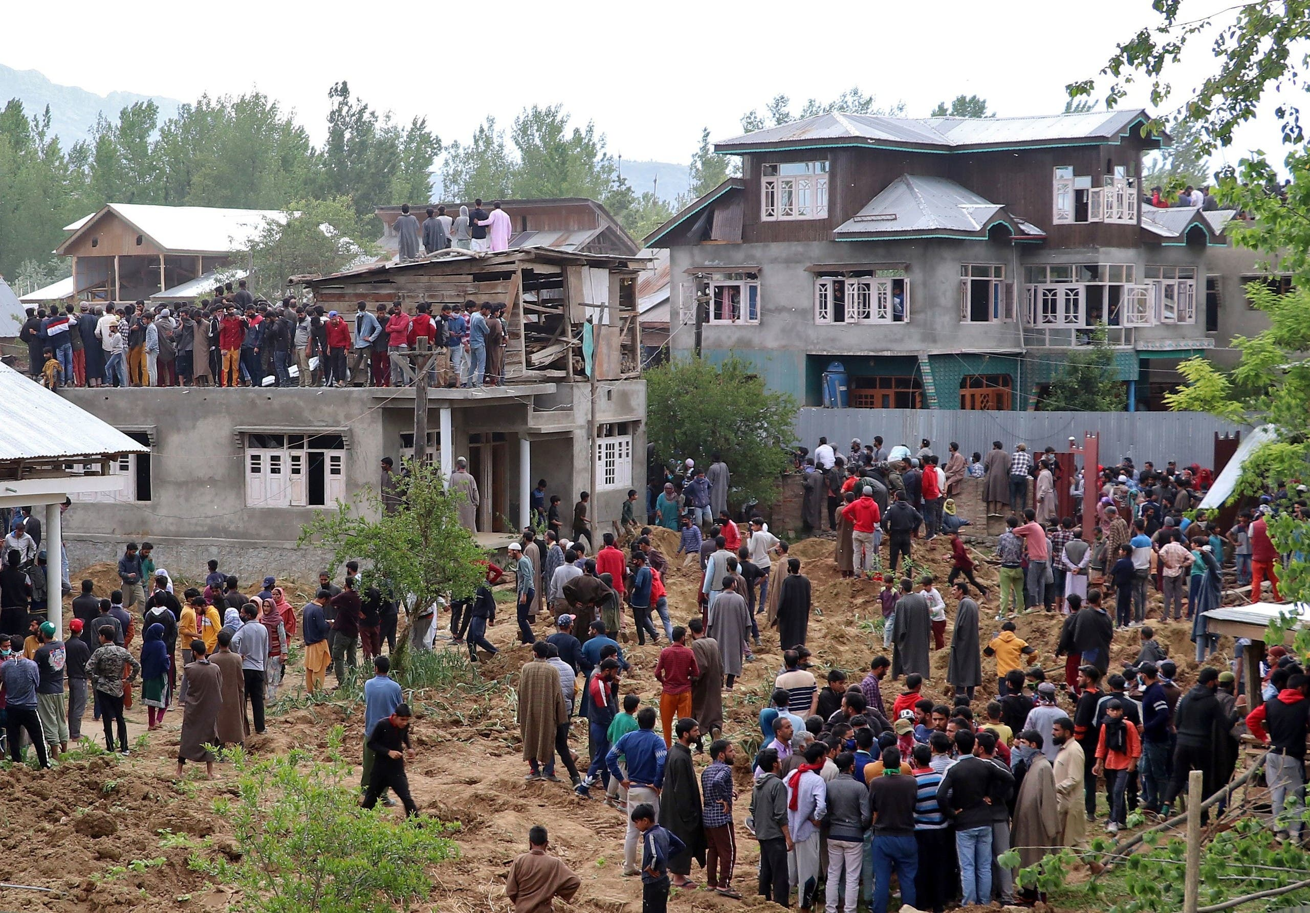 People gather after two militants were killed in a gun battle with Indian soldiers at Beighpora village in south Kashmir's Pulwama district, on May 6, 2020. (Reuters)