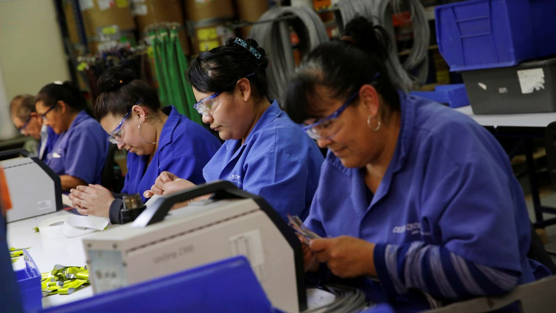 Operators work at a wire harness and cable manufacturing plant as the fast-spreading coronavirus outbreak has rippled through the global economy and upended supply chains, in Ciudad Juarez, Mexico March 11, 2020. (Reuters)