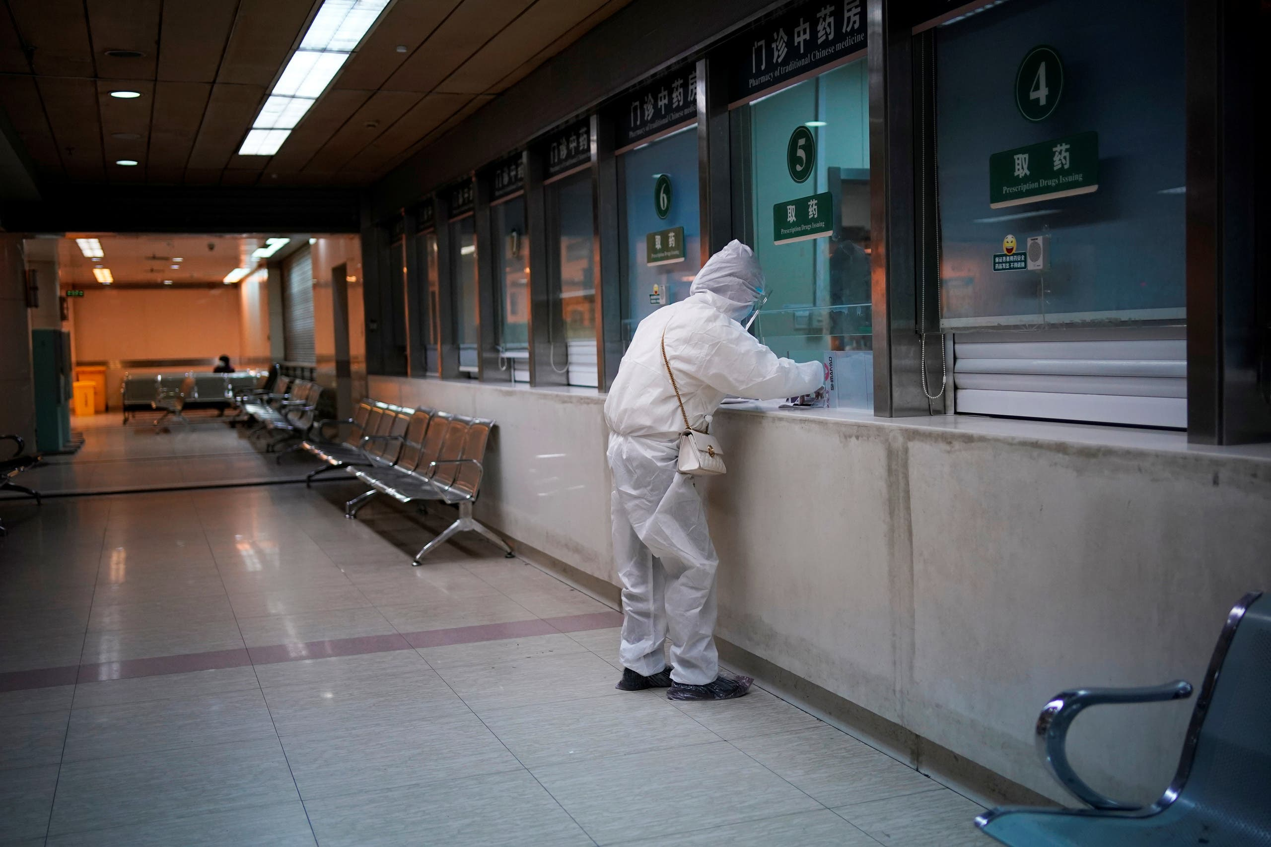 A woman wearing protective suit is seen at a hospital after the lockdown was lifted in Wuhan, capital of Hubei province and China's epicentre of the novel coronavirus disease (COVID-19) outbreak, April 13, 2020. (Reuters)
