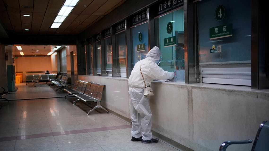 A woman wearing protective suit is seen at a hospital after the lockdown was lifted in Wuhan, capital of Hubei province and China's epicentre of the novel coronavirus disease (COVID-19) outbreak, April 13, 2020. REUTERS/Aly Song