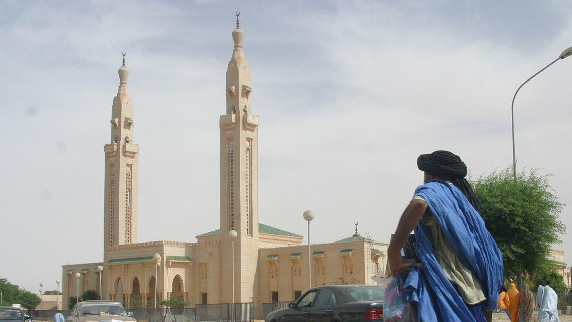 A man walks near a mosque in Nouakchott, Mauritania on November 9, 2003. (Reuters)