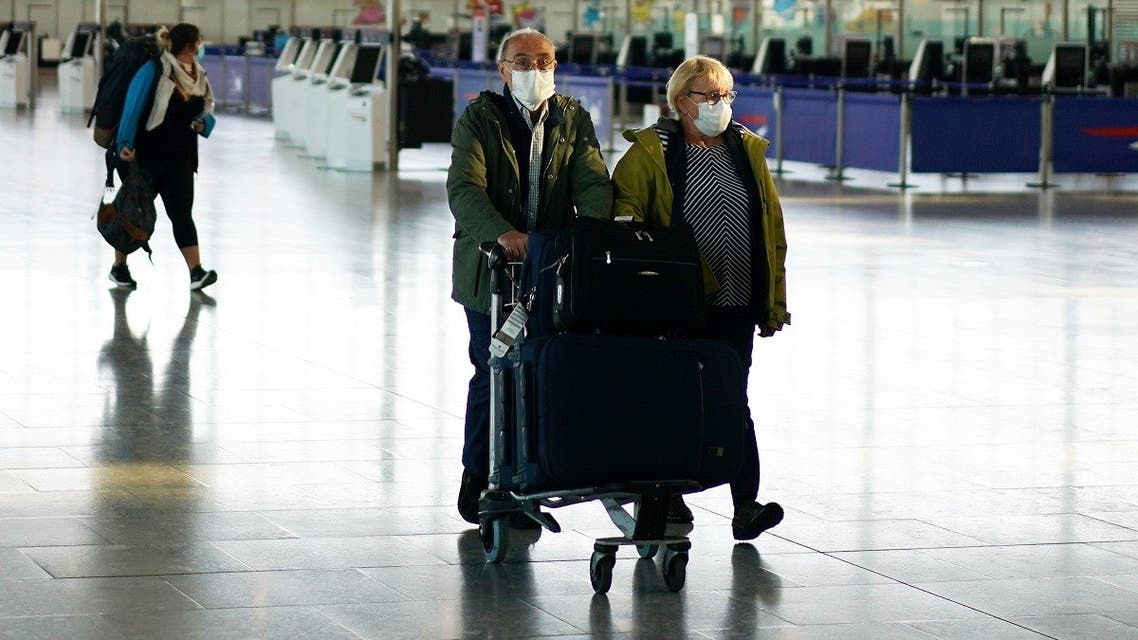People wearing masks are seen at Heathrow airport, as the spread of the coronavirus disease (COVID-19) continues, London, Britain, April 5, 2020. (Reuters)