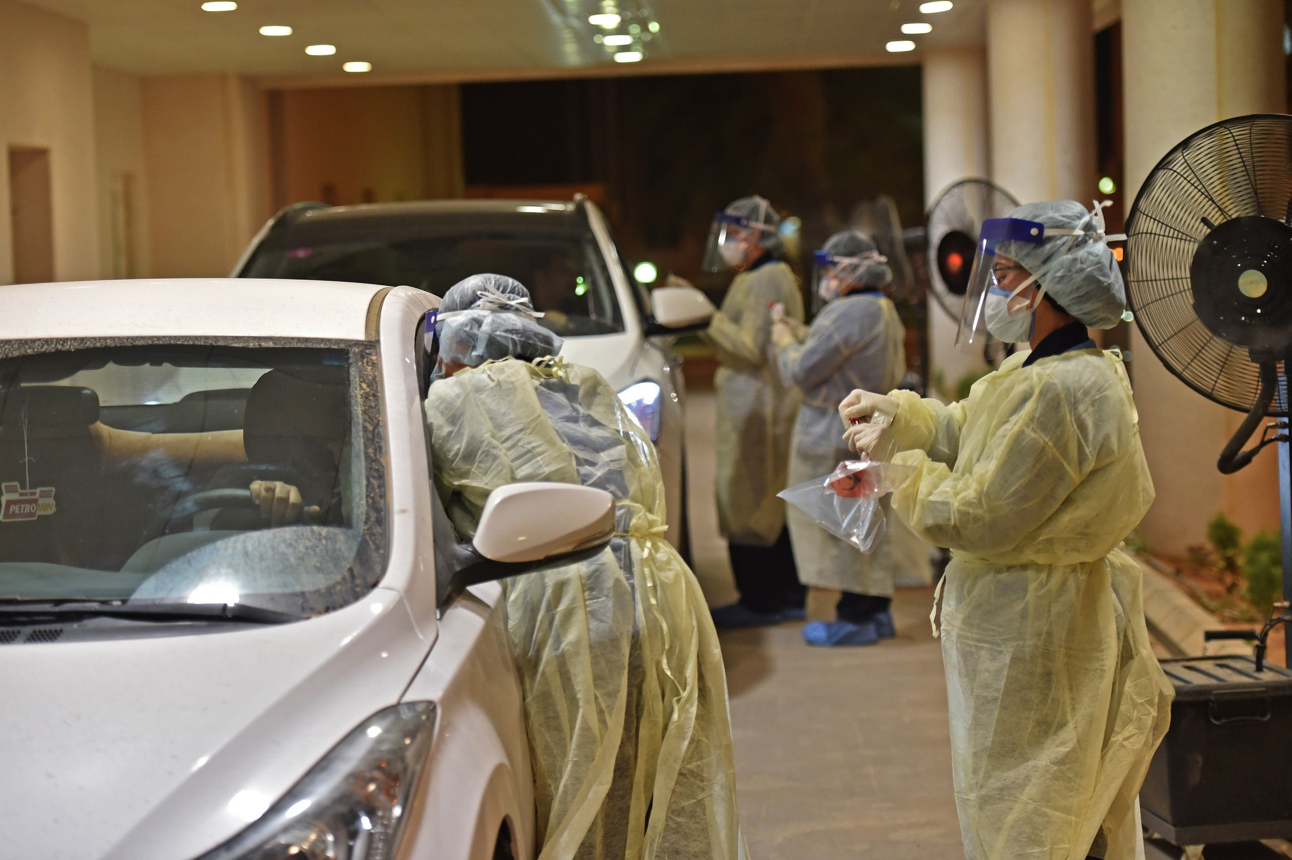 Health workers perform a nose swab test during a drive through coronavirus test campaign held in Diriyah hospital in the Saudi capital Riyadh on May 7, 2020 amid the COVID-19 pandemic. (File photo)